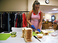 Pictured: Linzi Isaac prepares cheese sandwiches at Jersey Park Pavilion in Swansea, UK. Friday 25 August 2017<br /> Re: Free food for children story, Swansea, Wales, UK.