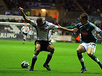 ATTENTION SPORTS PICTURE DESK<br /> Pictured: Darren Pratley of Swansea (L) marked by Shane Lowry (R) of Plymouth Argyle<br /> Re: Coca Cola Championship, Swansea City Football Club v Plymouth Argyle at the Liberty Stadium, Swansea, south Wales. Tuesday 08 December 2009