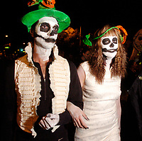 Christopher Waller (left) and his fiancee, Jessica Van Woerkom, walk in the All Souls' Procession on North Fourth Avenue Sunday night. About 3000 people took park in the procession.