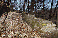 """Switzerland. Canton Ticino. Novaggio. Dry-stone walls on the """"Sentiero delle Meraviglie"""" which is a walking path. This type of wall, always built with material found on the spot. The """"Sentiero delle Meraviglie"""" is a guided trail which is plunged into nature, but every so often signs of human activity appear. Novaggio is located in the Malcantone area. 16.03.2010 © 2010 Didier Ruef"""