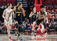 COLLEGE PARK, MD - DECEMBER 28: Kayla Robbins #5 and Akienreh Johnson #14 of Michigan start an attack. during a game between University of Michigan and University of Maryland at Xfinity Center on December 28, 2019 in College Park, Maryland.