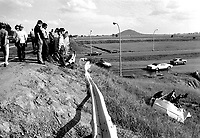 MONTREAL, CANADA - File Photo - People look at the severed parts of a car involved in a Fatal  accident on a Quebec  highway in the seventies (date unknown).<br /> <br /> File Photo : Agence Quebec Presse - Alain Renaud
