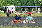 Keeping score, umpires for the game 'Te Ano'. Funafuti, Tuvalu