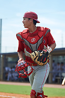 GCL Phillies East catcher Micah Yonamine (18) during a Gulf Coast League game against the GCL Yankees East on July 31, 2019 at Yankees Minor League Complex in Tampa, Florida.  GCL Yankees East defeated the GCL Phillies East 11-0 in the first game of a doubleheader.  (Mike Janes/Four Seam Images)
