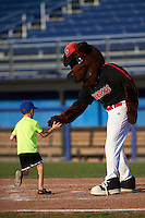 Young Batavia Muckdogs fan runs the base with mascot Homer after a game against the West Virginia Black Bears on August 21, 2016 at Dwyer Stadium in Batavia, New York.  West Virginia defeated Batavia 6-5. (Mike Janes/Four Seam Images)
