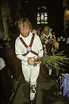 Rush Bearing ceremony Wingrave Buckinghamshire. England. Whitchurch Morris men place strew rushes symbolically around the church during the service.