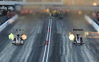 Feb. 22, 2013; Chandler, AZ, USA; NHRA top fuel dragster driver Doug Kalitta (left) races alongside Larry Dixon during qualifying for the Arizona Nationals at Firebird International Raceway. Mandatory Credit: Mark J. Rebilas-