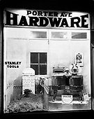 """0720-11.  Shop window of Porter Ave. Hardware advertising Dexter Washing Machines with a housewife poem. San Fernando, CA. """"Here lies the body of Cynthia Green who longed for a Dexter washing machine. For o'er the washtub her life she bent. A youthful life prematurely spent."""""""