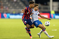 KANSAS CITY, KS - JULY 11: Nicholas Gioacchini #8 of the United States battles with Martin Experience #17 of Haiti during a game between Haiti and USMNT at Children's Mercy Park on July 11, 2021 in Kansas City, Kansas.