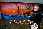 Artist Ciara McKenna standing at her newly created mural on the Tralee Greenway on Monday.