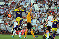 Valencia, Spain. Thursday 19 September 2013<br /> Pictured L-R: An ecstatic Michu of Swansea jumps in the air when match referee Serge Gumienny shows Adil Rami of Valencia (not pictured)  a straight red card for bringing down Wilfried Bony of Swansea (R background).<br /> Re: UEFA Europa League game against Valencia C.F v Swansea City FC, at the Estadio Mestalla, Spain,