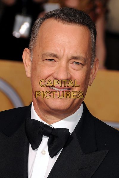 18 January 2014 - Los Angeles, California - Tom Hanks. 20th Annual Screen Actors Guild Awards - Arrivals held at The Shrine Auditorium. Photo Credit: Byron Purvis/AdMedia<br /> CAP/ADM/BP<br /> ©Byron Purvis/AdMedia/Capital Pictures
