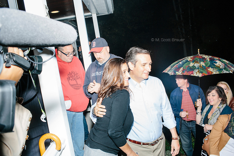 """Texas senator and Republican presidential candidate Ted Cruz greets people after speaking at an event called """"Smoke a cigar with Ted Cruz"""" at a house party at the home of Linda & Steven Goddu Salem, New Hampshire. Cruz briefly smoked a cigar after speaking at the event."""