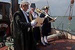 The annual Colchester Opening of the Colne Oyster Fishery, Brightlingsea, Essex. 2021. The annual event takes place on the first Friday in September aboard the Thistle a Thames Barge. Adrian Pritchard - Chief Executive reads the Proclamation, and with the Mayor  Cllr Robert Davidson drink a Loyal Toast, with gin and gingerbread.  <br /> Paul Lind is the Town Serjeant with Mace.