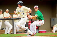 Stephen Schoettmer #13 of the Wake Forest Demon Deacons is tagged out by North Carolina State Wolfpack third baseman Trea Turner #8 at Doak Field at Dail Park on March 17, 2012 in Raleigh, North Carolina.  The Wolfpack defeated the Demon Deacons 6-2.  (Brian Westerholt/Four Seam Images)