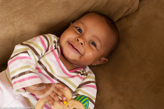 Smiling 7 month old baby girl