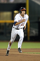 Daniel Pinero #22 of the Virginia Cavaliers runs during Game 4 of the 2014 Men's College World Series between the Virginia Cavaliers and Ole Miss Rebels at TD Ameritrade Park on June 15, 2014 in Omaha, Nebraska. (Brace Hemmelgarn/Four Seam Images)