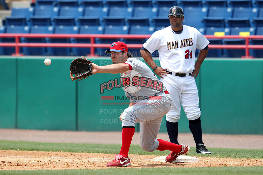 Clearwater Threshers first baseman Jim Murphy #44 takes a throw as catcher/first base coach Shawn Zarraga #24 looks on during a game against the Brevard County Manatees at Space Coast Stadium on April 30, 2012 in Viera, Florida.  Clearwater defeated Brevard County 5-1.  (Mike Janes/Four Seam Images)