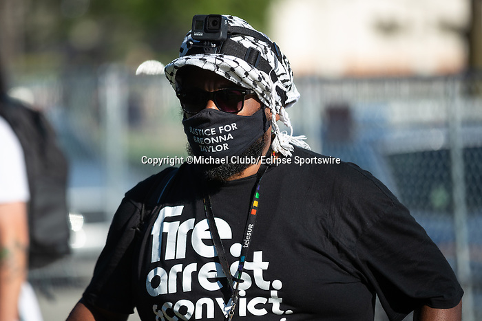 "September 5, 2020: A Black Lives Matter protester stands outside of Churchill Downs  the 146th Kentucky Derby. With the Kentucky Derby being the biggest sports event for the State of Kentucky, protestors have chosen the  event as a focal point for their calls for justice in the death of Breonna Taylor. Multiple groups from around the country have converged on Louisville to protest during the ""Run for the Roses"" at Churchill Downs in Louisville. Michael Clubb/Eclipse Sportswire/CSM"