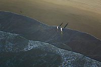 aerial photograph of a woman and girl on a California beach in the late afternoon