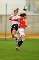 Cat Whitehill wins a header over a Norwegian player. The USA defeated Norway 2-1 at Olhao Stadium on February 26, 2010 at the Algarve Cup.