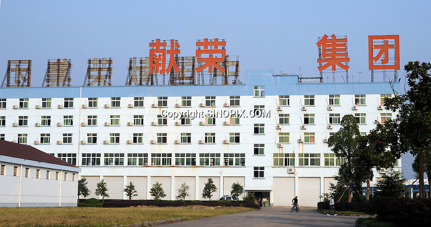 Yiwu Festival Gifts Co Ltd in Yi Wu, China. The factory makes Christmas trees for UK retail giant B & Q. Yi Wu exports 40-50 % of the entire European Christmas decorations and 70 % of US and Mexico's Christmas gifts come from Yi Wu.