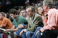 John Grisham attends a Virginia basketball game.