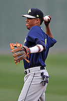 Shortstop Milton Ramos (7) of the Columbia Fireflies warms up before a game against the Greenville Drive on Thursday, April 21, 2016, at Fluor Field at the West End in Greenville, South Carolina. Columbia won, 13-9. (Tom Priddy/Four Seam Images)