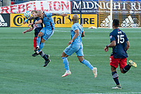 FOXBOROUGH, MA - SEPTEMBER 19: Scott Caldwell #6 of New England Revolution and Alexandru Mitrita #28 of New York City FC compete for a high ball during a game between New York City FC and New England Revolution at Gillette on September 19, 2020 in Foxborough, Massachusetts.