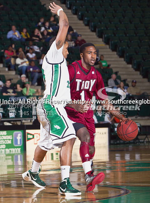 Troy Trojans guard Will Weathers (1) and North Texas Mean Green guard Brandan Walton (2) in action during the game between the Troy Trojans and the University of North Texas Mean Green at the North Texas Coliseum,the Super Pit, in Denton, Texas. UNT defeats Troy 87 to 65.....