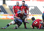 Ospreys captain Justin Tipuric tackles Munster hooker BJ Botha.<br /> Guiness Pro12<br /> Ospreys v Munster<br /> Liberty Stadium<br /> 07.03.15<br /> ©Steve Pope - SPORTINGWALES