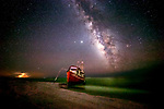 The shrimp boat Donna Kay pictured between a lightning storm and the Milky Way is washed up on the beach by Hurricane Michael.  The ship wreck is located at Cape San Blas along the Gulf coast in Gulf County near Port St Joe in the north Florida panhandle.