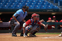 Catcher Ian Moller (40) of Wahlert Catholic School in Dubuque, IA playing for the Cincinnati Reds scout team sets a target as home plate umpire Lance Weems looks on during the East Coast Pro Showcase at the Hoover Met Complex on August 5, 2020 in Hoover, AL. (Brian Westerholt/Four Seam Images)