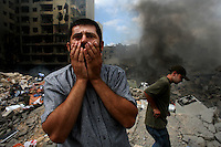 Beirut, Lebanon, Aug 13 2006.Ahmad hassan Razik, 35, fears for his brother Haidar Razik, 40, who was working as the school maintenance engineer at the time of the blasts. A massive Israeli Air Force bombing destroyed 11 building blocks in the southern Beirut neighbouhood of Rwaiss, including the Imam Hassan school, totally levelled by more than 20 powerful bombs; more than 20 people, including children playing in the area are said to have lost their lives as a result of this 11th hour Israeli operation..