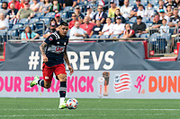 FOXBOROUGH, MA - AUGUST 8: Gustavo Bou #7 of New England Revolution brings the ball forward during a game between Philadelphia Union and New England Revolution at Gillette Stadium on August 8, 2021 in Foxborough, Massachusetts.