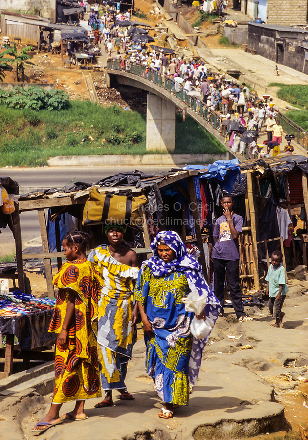 Abidjan, Ivory Coast, Cote d'Ivoire.  Pedestrian Bridge over Divided Highway.