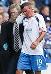 Derek Lyle goes off with a wee scratch