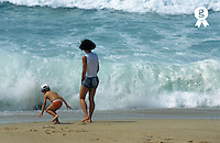 Mother (30-35) and son (4-5)  playing on beach, Atlantic Ocean, Portugal (Licence this image exclusively with Getty: http://www.gettyimages.com/detail/82406742 )