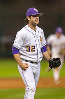 LSU Tigers pitcher Alden Cartwright (32) celebrates the end of the eight inning of the NCAA baseball game against the Houston Cougars on March 6, 2015 at Minute Maid Park in Houston, Texas. LSU defeated Houston 4-2. (Andrew Woolley/Four Seam Images)
