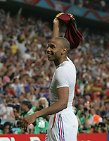 French forward (12) Thierry Henry salutes the crowd after the game.  France defeated Portugal, 1-0, in their FIFA World Cup semifinal match at FIFA World Cup Stadium in Munich, Germany, July 5, 2006.