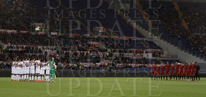 """Calcio, Serie A: Roma, stadio Olimpico, 25 ottobre 2017.<br /> AS Roma's and Crotone's players listen to a speaker reading a passage from the diary of holocaust victim Anne Frank before the Italian Serie A football match between AS Roma and Crotone at Rome's Olympic stadium, October 25, 2017.<br /> Few days ago Lazio fans posted anti-semitic photos of Anne Frank in a Roma jersey in the stands of the Stadio Olimpico. The Italian football federation announced that there will be a minute's reflection on the Holocaust before every match and a passage read from """"The Diary of Anne Frank"""". At the same time referees and captains will hand out copies of the diary and Italian Jewish writer Primo Levi's memoir """"If This Is A Man"""".<br /> UPDATE IMAGES PRESS/Isabella Bonotto"""