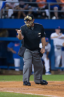 Home plate umpire Tony Norris makes a strike call in Game One of the Gainesville Super Regional of the 2017 College World Series between the Wake Forest Demon Deacons and the Florida Gators at Alfred McKethan Stadium at Perry Field on June 10, 2017 in Gainesville, Florida.  The Gators defeated the Demon Deacons 2-1 in 11 innings.  (Brian Westerholt/Four Seam Images)