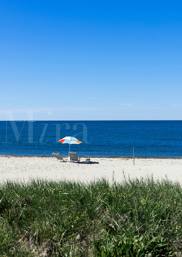 Beach umbrella and chairs, West Dennis Beach, Cape Cod, Massachusetts, USA.