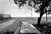 Zabolottay, Ukraine.August 1998.A young boy waits for the workers of the Prekordonnek kolhoz to take lunch near their fields that border, Romania on one side, and Hungary on the other..