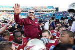 Retiring Florida State head coach Bobby Bowden takes a ride off the field after coming from behind to defeat West Virginia 33-21 in Jacksonville, Florida January 1, 2010.  It was coach Bowden's final game.