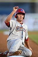 Clearwater Threshers third baseman Mitch Walding (10) slides into third during a game against the Dunedin Blue Jays on April 10, 2015 at Florida Auto Exchange Stadium in Dunedin, Florida.  Clearwater defeated Dunedin 2-0.  (Mike Janes/Four Seam Images)
