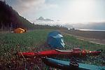 Alaska, Sea Kayak campsite, Kenai Fjords National Park, U.S.A. Feathercraft breakdown aluminun and fabric kayaks.