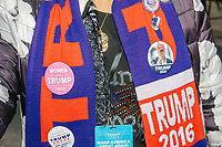 Lynda Payette, of Bethlehem, NH, wears bedazzled Trump clothing including a hat, 2020 shirt, scarf, and various buttons and other campaign paraphernalia, before US President Donald Trump arrives at a Make America Great Again Victory Rally in the final week before the Nov. 3 election at Pro Star Aviation in Londonderry, New Hampshire, on Sun., Oct. 25, 2020.