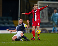 19th December 2020; Dens Park, Dundee, Scotland; Scottish Championship Football, Dundee FC versus Dunfermline; Kyle Turner of Dunfermline Athletic is tackled by Charlie Adam of Dundee