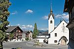 Austria, Vorarlberg, Schwarzenberg: village centre with fountain, parish church and listed (landmarked) buildings | Oesterreich, Vorarlberg, Schwarzenberg: Ortskern mit Brunnen, Pfarrkirche und denkmalgeschuetzten Haeusern